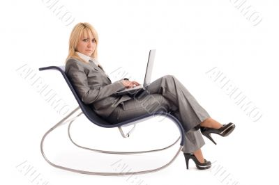 Businesswoman with laptop rest in chair over white