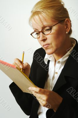 Beautiful Woman Thinks with Pencil & Notepad Taking Notes