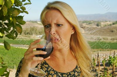 Shocked Attractive Woman Sips Wine