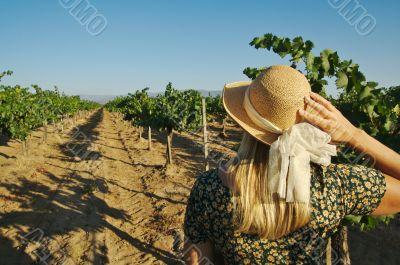 Beautiful Woman Strolling at a Winery