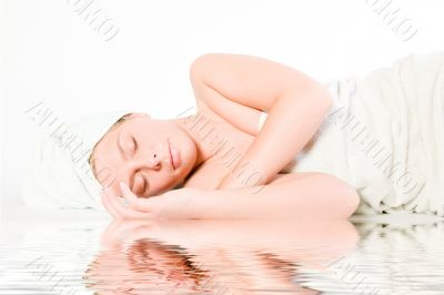 Wellness girl series laying down asleep by the water
