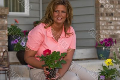 Woman Gardener Planting Flower