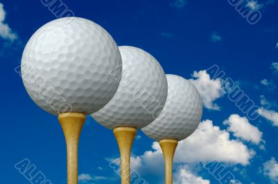 Three Golf Balls & Tees