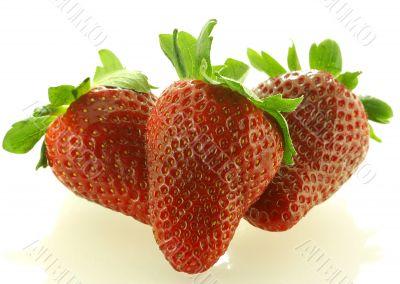 Close up shot of three ripe strawberry