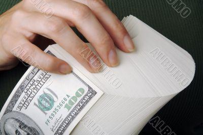 Woman fanning Large Stack of One Hundred Dollar Dollar Bills
