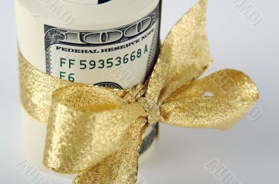 One Hundred Dollar Bills Wrapped in Gold Ribbon.