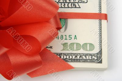 One Hundred Dollar Bills Wrapped in Red Ribbon.