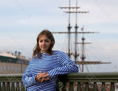 Beauty girl in sailor`s striped vest