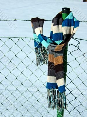 fence with scarf
