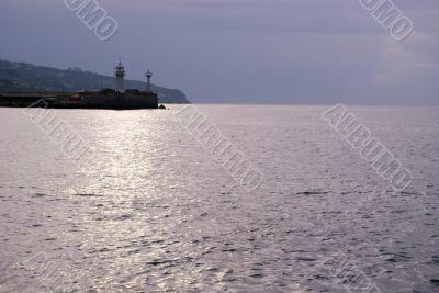 Cloudy sunrise above seamark, Yalta