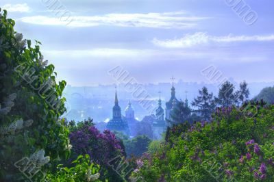 Vydubychi Monastery with blooming lilac