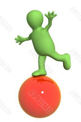 3d puppet, balancing on a red ball