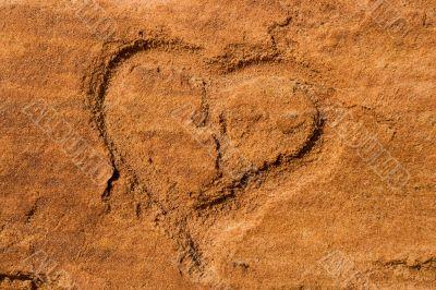 Heart scraped into sandstone
