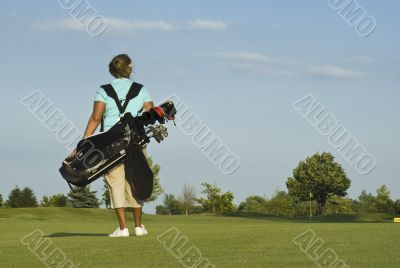 Woman Golfer Carrying Golf Clubs