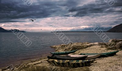 waterscape with boats and dramatic sky