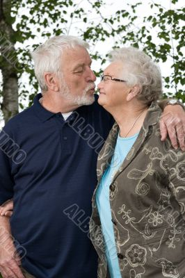Older couple outside and in love