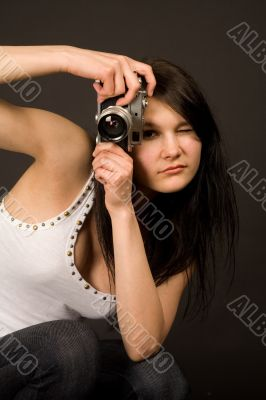Beautiful fashion girl with camera