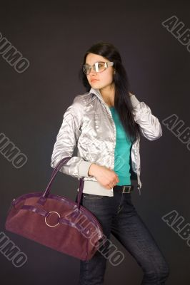 Fashion girl in designer glasses