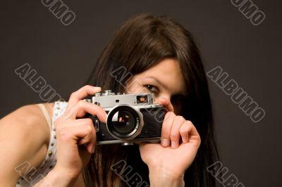 Playful girl photographer, focus on camera