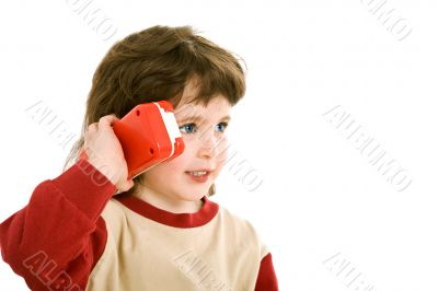 child with a toy telephone