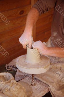 potter makes pitcher