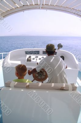 little boy and captain on the boat 2