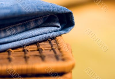 jeans atop of a basket
