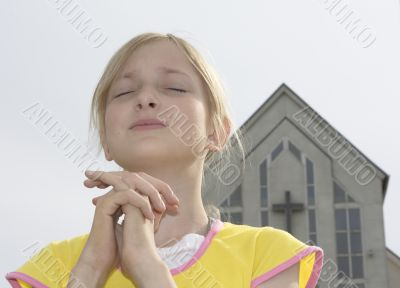 Teenager girl praying