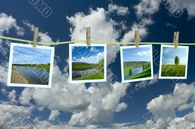 Landscape photographs hanging on a clothesline against a cloudscape