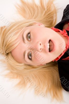 Portrait of astonished blond woman