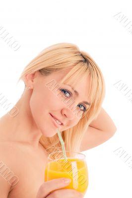 Attractive girl drinking fresh orange juice