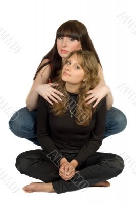 Two beauty young embracing women. Isolated.