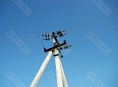 Ferro-concrete column with electric wires.