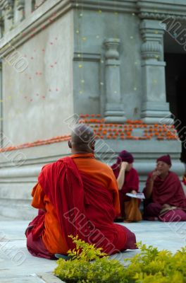 Buddhistic monk in front of stupa