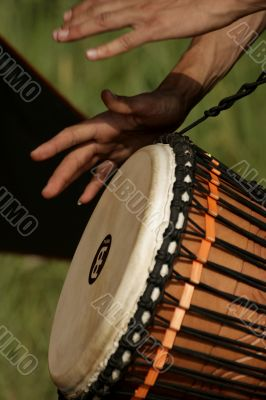 Hands of the person playing on a drum