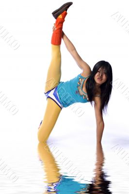 Asian fashion model stretching her leg