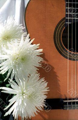 Guitar with three chrysanthemums