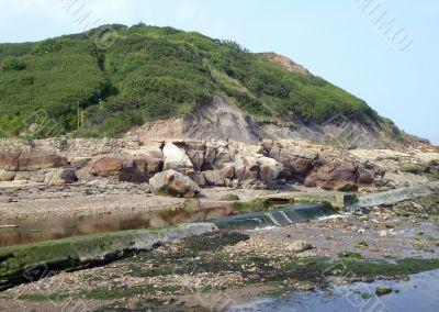 Rock pools by seashore