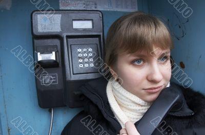Upset girl with street phone