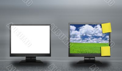 two lcd screens against abstract background