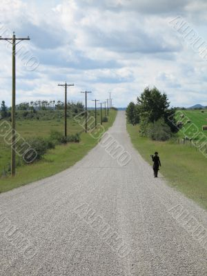 person walking on a dirt road