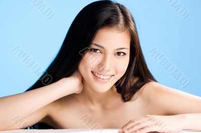 beautiful young asian girl  on blue background