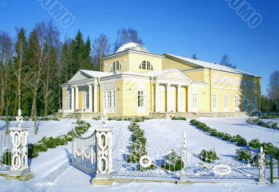 Wooden classical building in winter