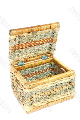 empty brown wicker basket isolated on white background