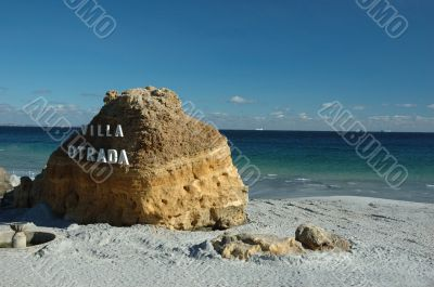 Big yellow rock on the uninhabited public beach