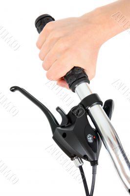 Hand holding bicycle handlebar