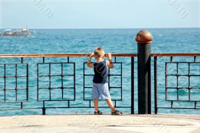 happy young boy looking horizon
