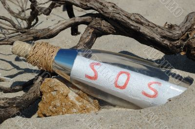 Message in a bottle with SOS signal