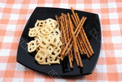 Crackers and salty sticks to beer