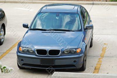 Parked Blue Sedan